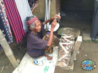 An elderly Sasak woman weaving in Lombok, Indonesia