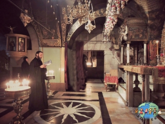 Armenian Orthodox Christians praying at the Church of the Holy Sepulchre