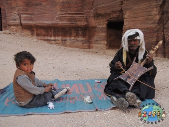 Bedouin grandfather plays the Rababa with grandson near Petra, Jordan