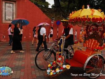 Bicycle Rickshaw driver in Malacca, Malaysia