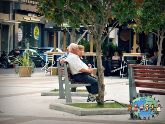 Greek couple resting in a park on a Sunday afternoon in Kalamata