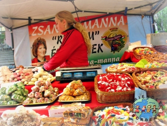 Hungarian saleslady sells varieties of candies in Pecs