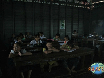 Khmer children study at the Vietnamese Catholic School in Tonle Spa (lake)