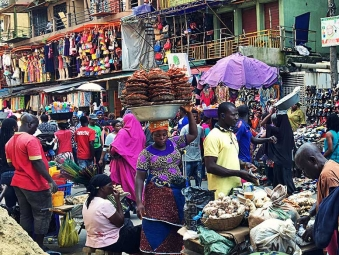 Vendors and shoppers swamp one of Lagos' local market in Nigeria