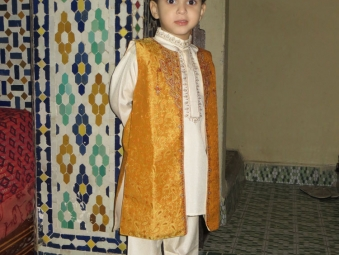 Little boy in a traditional dress in a home in the old city of Fes