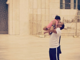 Man with his baby girl at the Hassan II Mosque in Casablanca