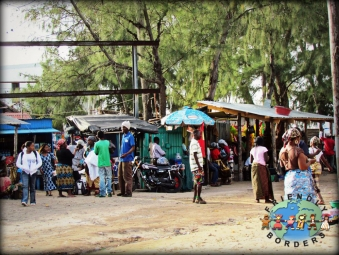 Mozambicans at a market in Tofo beach Mozambique