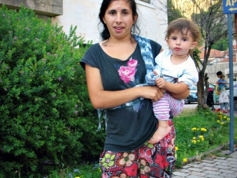 Roma Montegrin mother and child pose for a picture in Kotor