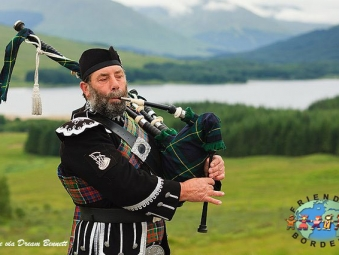 Scottish Man playing a bagpipe, Scotland