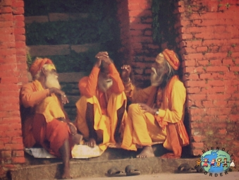 Three Sadhus sit together at Pashupatinath Temple in Kathmandu