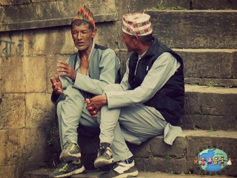 Two Nepali men chat at Pashupatinath Temple in Kathmandu