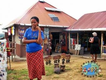 A woman selling ornaments on a street market in Uganda