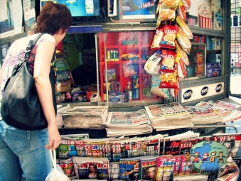 Young Serbian woman at a magazine stand in Belgrade