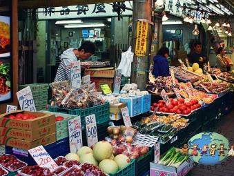 Vendors selling various products to their customers in Ameyoko market in Tokyo, Japan