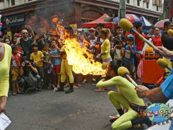 A fire dancer performs along Ongpin Street in Manila Chinatown, Philippines