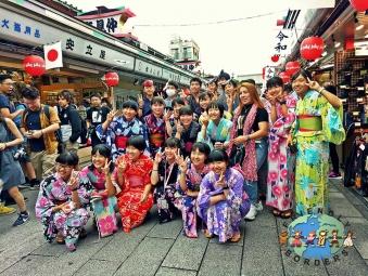 Japanese girls and boys wearing traditional Yukata for summer wear in Nakamise-dori Street in Asakusa, Tokyo