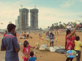 Boys, girls and adults fly kites along Galle Face Green in Colombo, Sri Lanka