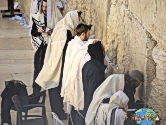 Orthodox Jews deep in prayer at the Wailing Wall in Jerusalem