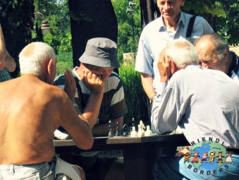 Serbian men playing chess in a park in Belgrade