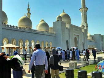 Visitors wait in line to enter the Sheikh Zayed Mosque in Abu Dhabi, one of the ten largest mosques in the world